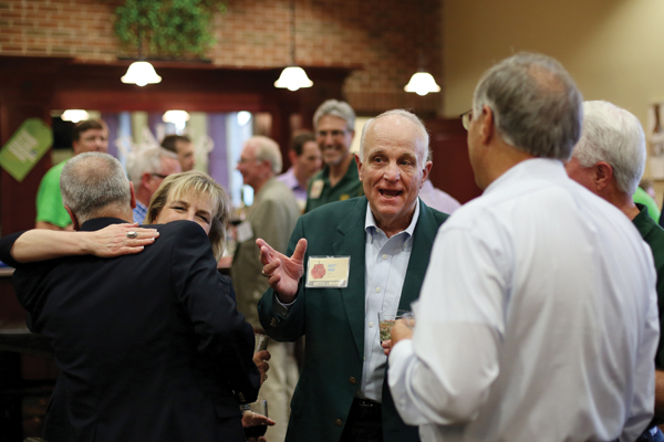 Matt Coco, CE'66, socializes with fellow alumni in the Bauer Bar during the 2015 Battle of the Brains.
