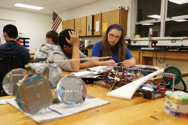 FIRST Robotics mentor Aysen Malone works with a team at Rolla High School on Tuesday Feb. 10, 2015.        Sam O'Keefe/Missouri S&T