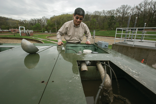 Jianmin Wang at Fort Leonard Wood with his waste water cleaning unit on April 15, 2015.         Sam O'Keefe/Missouri S&T