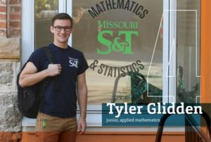 Student in front of Mathematics and Statistics window